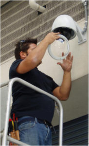 image of technician installing security camera
